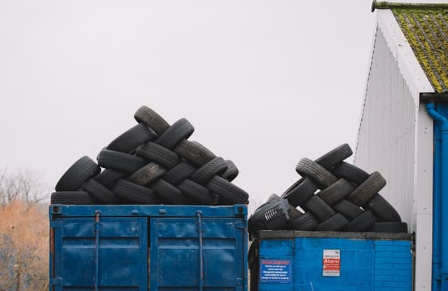 Vehicle tires piled up in two lorries.